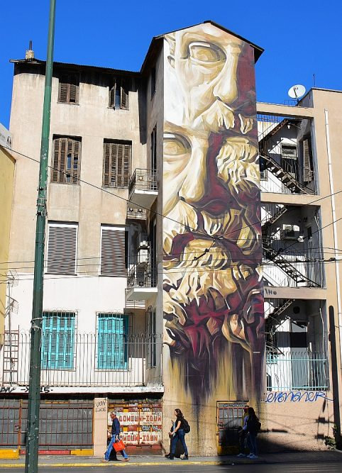 "street art in Athene ""System of a Fraud"" by INO"
